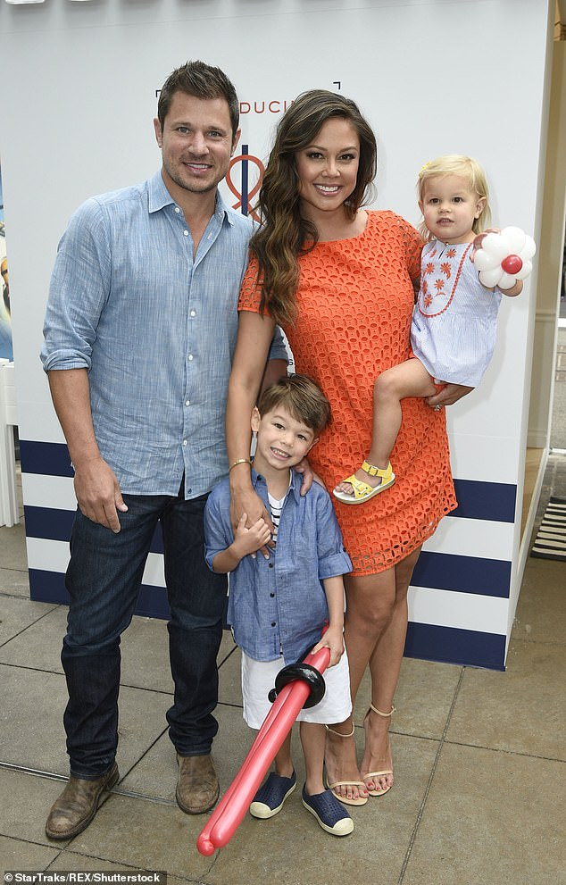 Domestic bliss: Nick and Vanessa tied the knot in 2011 and are now parents to sons Camden, seven, Phoenix, three, and daughter Brooklyn, five (pictured with children Camden and Brooklyn in 2017)