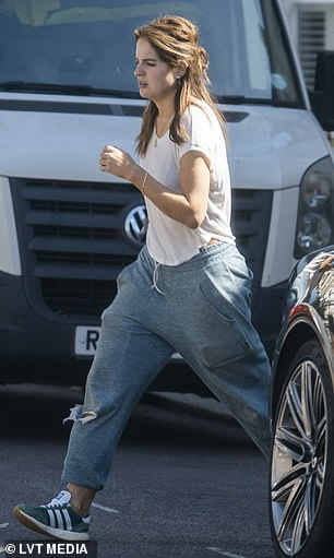 Low-key: Binky wore a pair of baggy grey joggers and teamed them with a loose-fitting white T-shirt