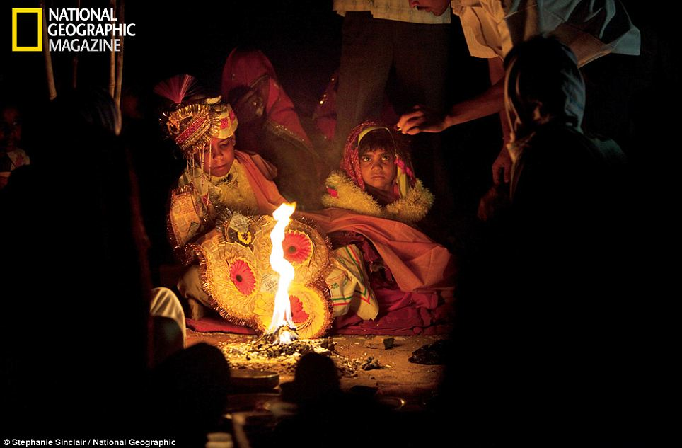 So young: Barely looking at each other, Rajani and her boy groom are married in front of the sacred fire. According to tradition, the young bride is expected to live at home until puberty, before she is transferred to her husband