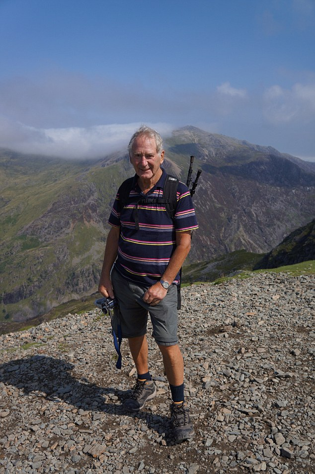 Super fit George, pictured on a hike, will climb Scafell Pike this summer as well as completing running, cycling and skiing challenges.