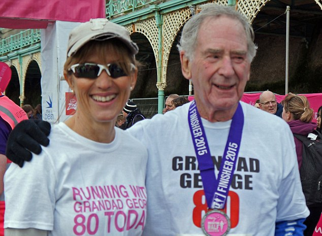 Grandad George pictured with his daughter Helen at the finish of the Brighton Half Marathon which he ran on his 80th birthday last February